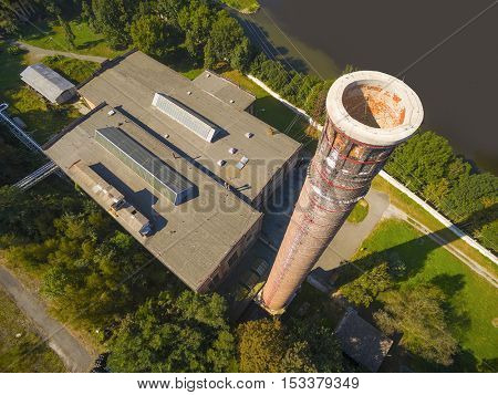 Aerial view of a power plant with big chimney. Heavy industry from above. Power and fuel generation in Czech Republic, European Union.