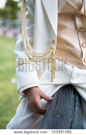 Detail closeup of the clothes of a young boy in his First Communion