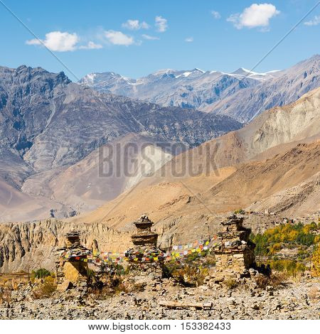 Buddhist chorten in front of mountain range. Muktinath in Nepal.