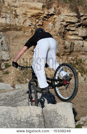 Young Off Road Mountain Biker Tackles Some Rocks