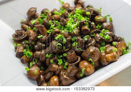 Sauteed fresh crimini mushrooms topped with green onion garnish