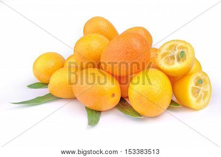Pile of kumquat and two its half isolated on white background with leaves.