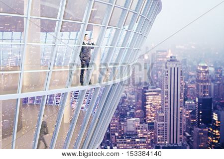 See through glass building exterior with businesspeople inside. Night city background. 3D Rendering