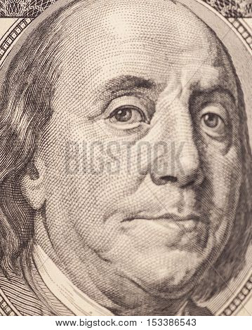 Macro shot of Benjamin Franklin portrait from a $100 bill