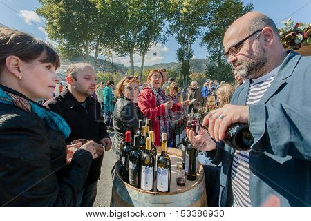 TBILISI, GEORGIA - OCT 16, 2016: People tasting wine at stores of the private wine companies during festival Tbilisoba on October 16, 2016. Tbilisoba is traditional festival in capital of Georgia from 1979