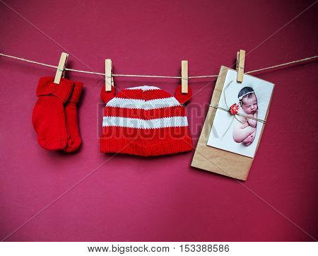 Baby Clothes And Greeting Card Hanging On The Clothesline.