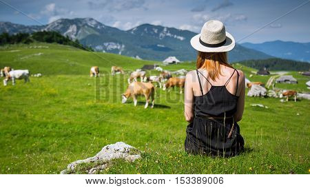 Beautiful Woman Enjoys Views Of The Alpine Village In The Mountains.