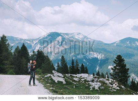 Family on trekking day in the mountains. Travel Lifestyle Concept. Velika Planina or Big Pasture Plateau in the Kamnik Alps Slovenia.