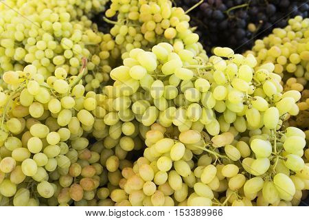 Grape. Wine grapes background. Green grapes. Grapes at market. It can be used as a food background (selective focus)