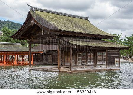Hiroshima Japan - September 20 2016: Non Painted open hall of itsukushima Shinto Shrine on Miyajima Island built barely above sea level.
