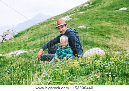 Family On A Trekking Day In The Mountains.
