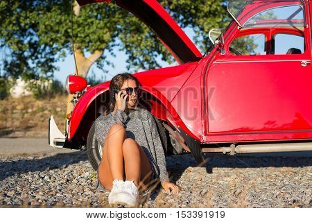 Woman on a roadtrip having a problem with her old car