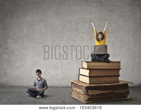 Teenagers using their laptops