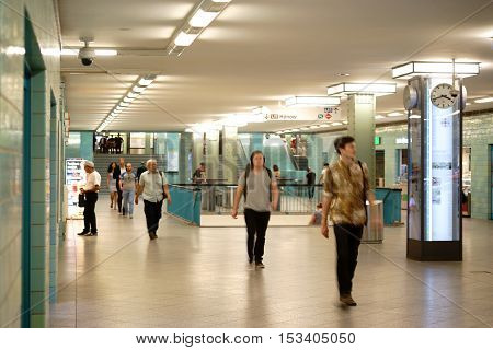 BERLIN, GERMANY - JUNE 21: An underpass or a tunnel of the underground station Berlin Alexander Square with passersby on June 21 2016 in Berlin.