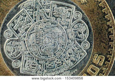 Tonatiuh ten mexican peso coin closeup detail