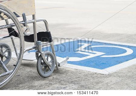 Pavement handicap symbol and wheelchair, close up