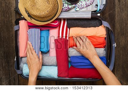 woman packing luggage for a new journey