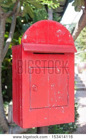 Old wooden red post box, stock photo