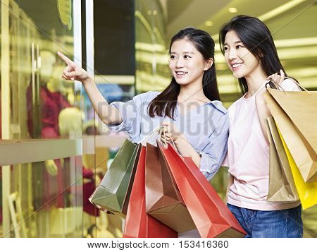 two beautiful young asian woman shopping in mall or department store