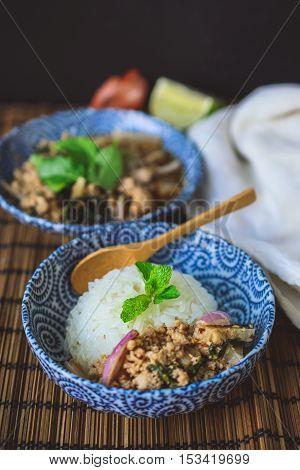 Lab Moo, Thai Spicy Minced Pork on Wood Background Thai Food on Wood Background Thai Spicy Food on Wood Background Thai Cuisine on Wood Background