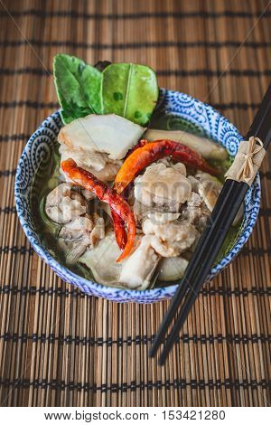 Tom Yum Gai, Thai Spicy Soup with Chicken and Wood Background Thai Food Thai Cuisine Thai Tradition