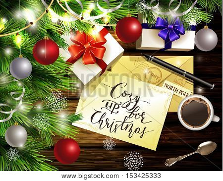 Christmas New Year design light wooden background with christmas tree and silver and red balls and wish list coffee teaspoon gift boxes envelope for santa and pen and handwritten Cozy up for Christmas.