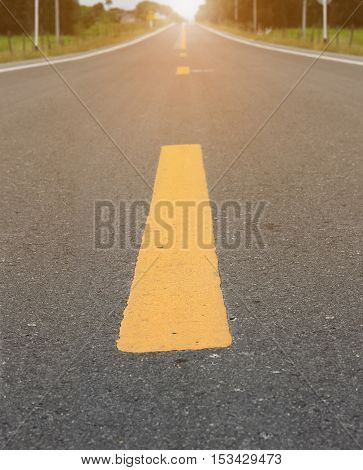 Close up road divide yellow line on asphalt