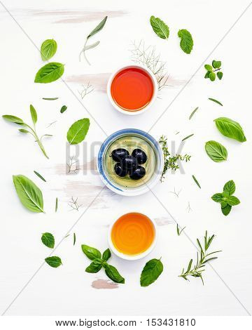 Different Sorts Of Cooking Oils. Olive Oil Flavored ,spice Oils And Sesame Oil With Herbs Rosemary ,