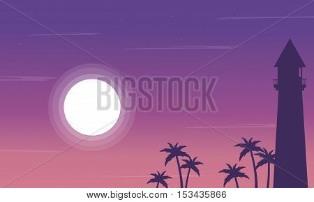 Silhouette of lighthouse and palm on the beach scenery