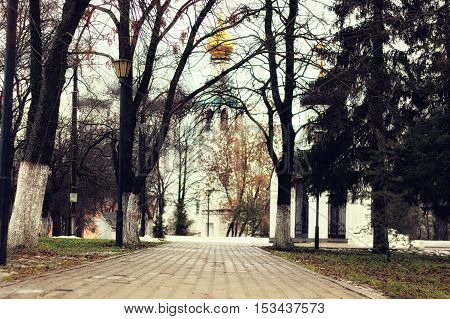late autumn with the rainy weather in the city park at the church building