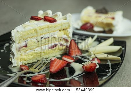 Delicious slice of cakes with fruit and strawberries shallow depth of field