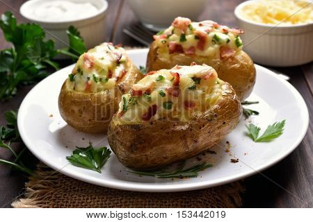 Stuffed potato with bacon cheese and green onion