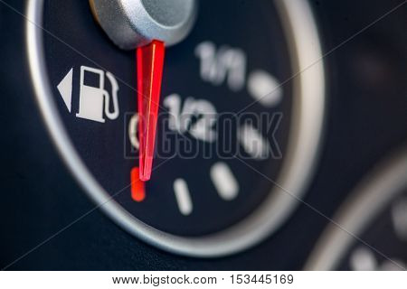 Color close up image of a car's fuel gauge.