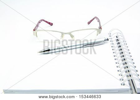 Education And Office Concept. Pen Notebook And Eyeglasses