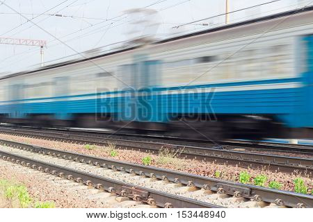 Several blue carriages of fast moving electric multiple unit blurred in motion