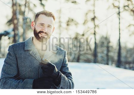 beautiful young bearded men relaxing on winter walk in snowy forest candid capture lifestyle scene