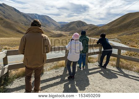 Otago New Zealand - February 2016: Tourists at scenic lookout of Lindis Pass on State Highway 8 (Tarras - Omarama - Lindis Pass Road) lies between the valleys of the Lindis and Ahuriri Rivers south island of New Zealand.