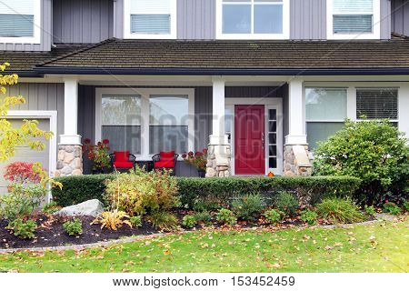 Traditional Canadian house with a red front door.