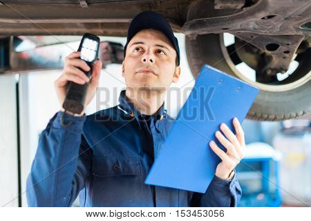 Auto electrician working on a car