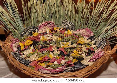 Colorful Butterfly And Tagliatelle Italian Pasta In Wicker Basket