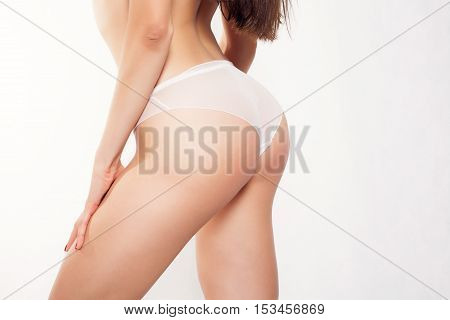 sexy curvy girl butt without cellulite. girl in white panties on a white background