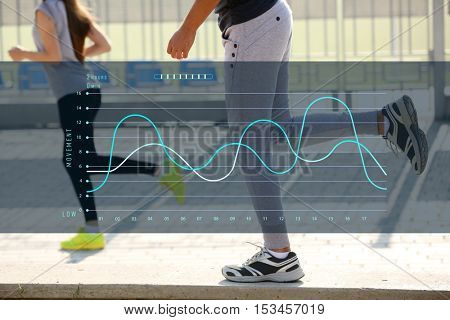 Closeup of people legs jogging at park. Graphic of training results. Health care and sport concept.