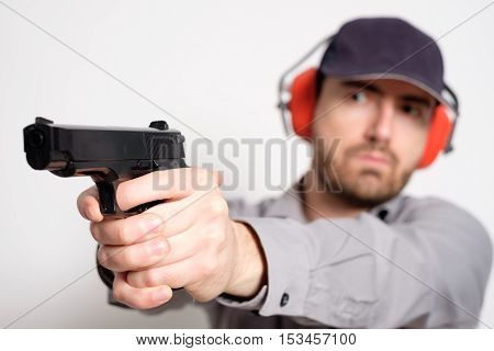 Man Holding A Gun In His Hand Ready To Shoot