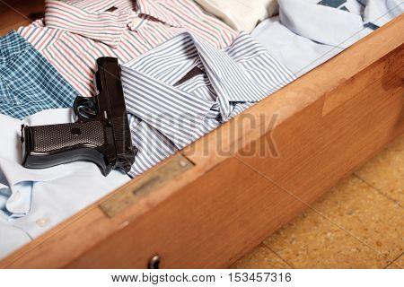 Gun Hidden In A Drawer Full Of Shirt At Home