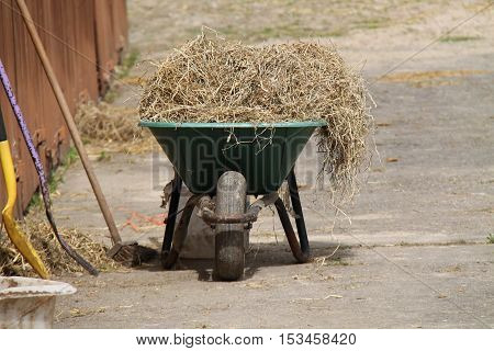 A Wheelbarrow Used for Mucking-out a Horse Stable.