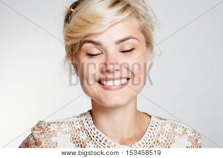 Lovely young woman smiling . Happy blond young woman smiling studio