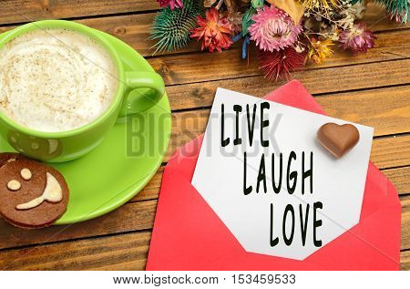 Live Laugh Love words on white paper