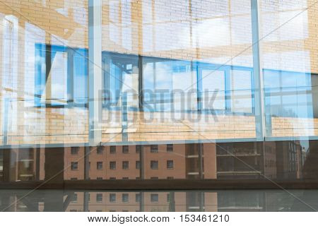 Building reflected in a window pane. Background