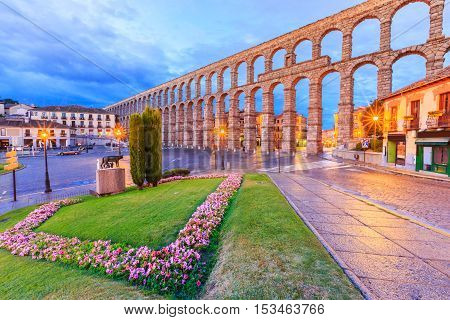 Segovia, Spain. Twilight view at Plaza del Azoguejo and the ancient Roman aqueduct.
