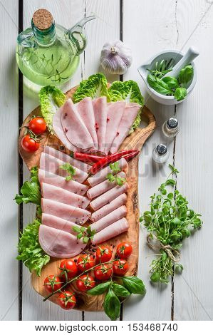 Closeup Of Smoked Cold Cuts With Pepper And Herbs